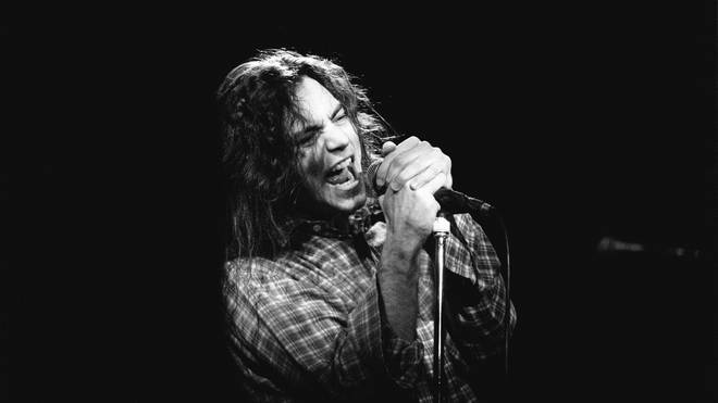Eddie Vedder performs with Pearl Jam in 1992