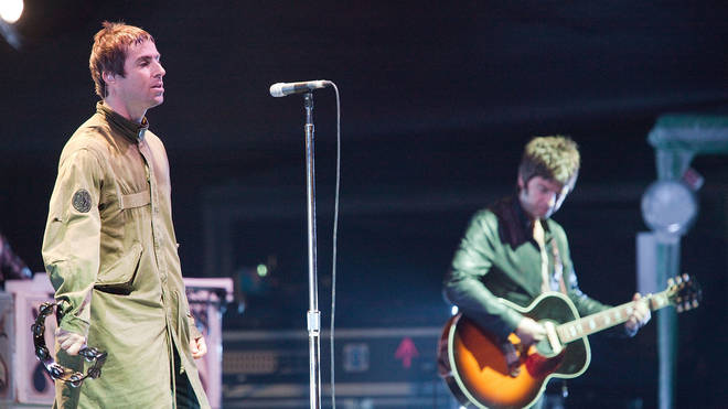 Liam and Noel Gallagher of Oasis during one of their final shows together, July 2009