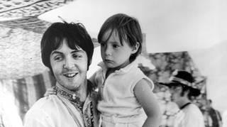 Paul McCartney holds four year old Julian Lennon