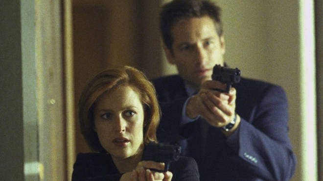 "Agent Dana Scully (Gillian Anderson) and agent Fox Mulder (David Duchovny) in the ""Hungry"" episode of The X-FIles, 1999"
