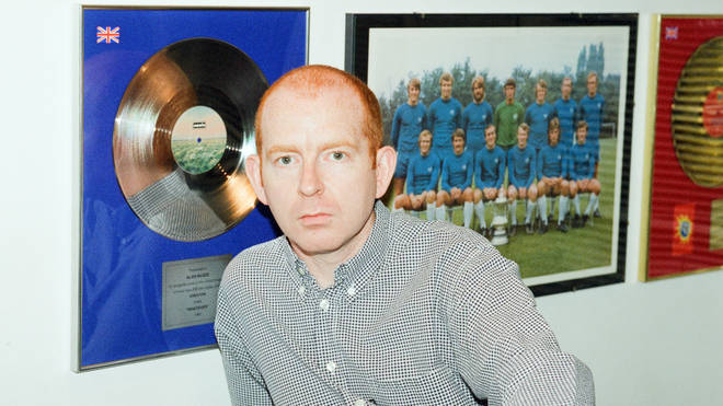 Alan McGee in his Creation Records office, 1996