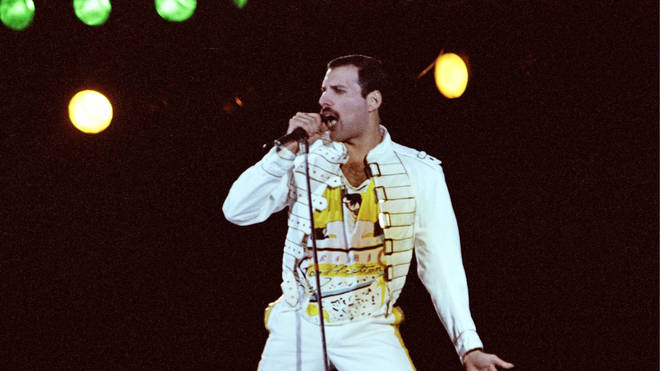 Freddie Mercury performing live on stage at Knebworth, 9 August 1986