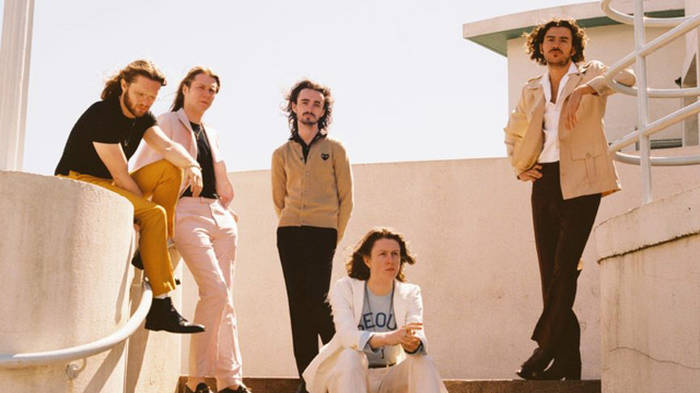 Text to win a guitar signed by Blossoms