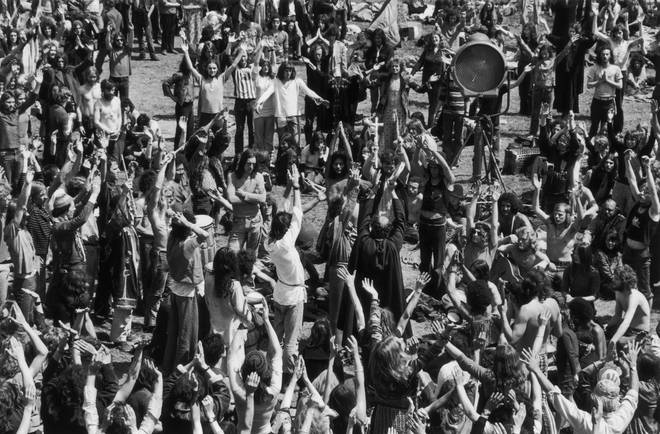 A group of hippies dancing during summer solstice celebrations at the second Glastonbury Festival.