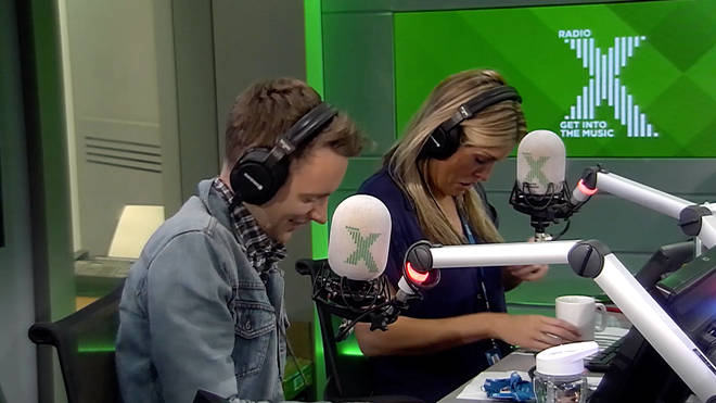 Pippa checks her popped button on her shirt during boob chat on The Chris Moyles Show