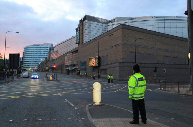 A police officer guards the area outside Manchester Arena the day after the 22 May 2017 attack