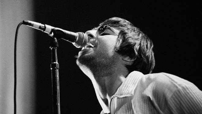 Liam Gallagher perfoming with Oasis in Utrecht, January 1996