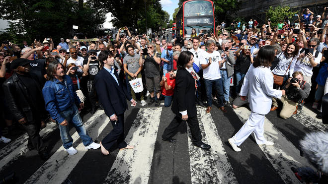 Members of the Fab Four re-enact The Beatles famous Abbey Road cover shoot, on the 50th Anniversary of the album.