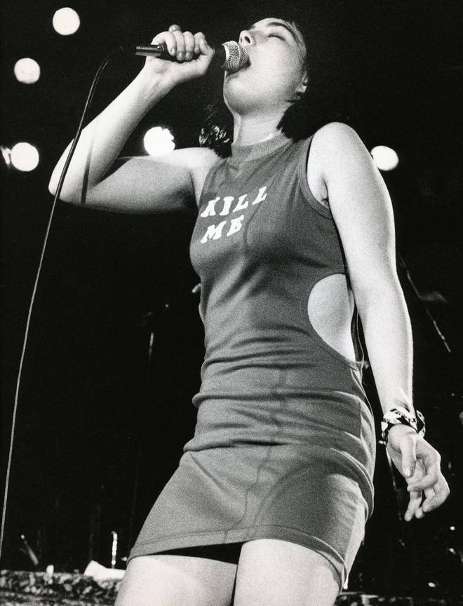 Singer Kathleen Hanna of the punk group Bikini Kill onstage in 1993