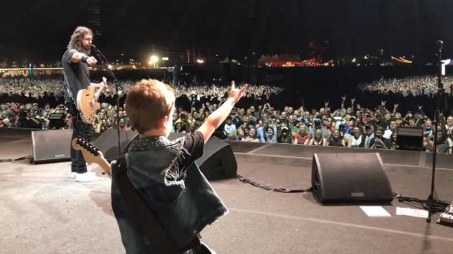 Foo Fighters' Dave Grohl welcomes the eight-year-old son of Anthrax guitarist Scott Ian on stage to play Everlong