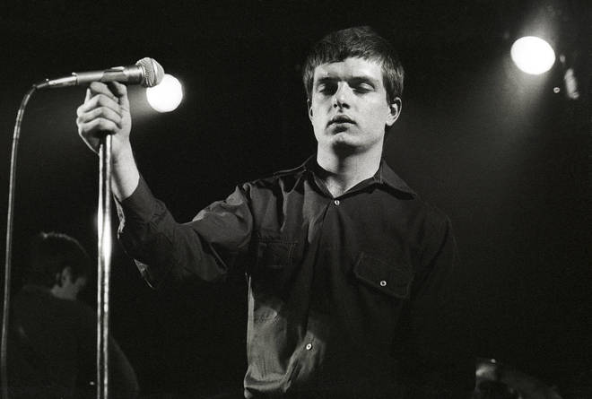 Ian Curtis of Joy Division performing live in 1980