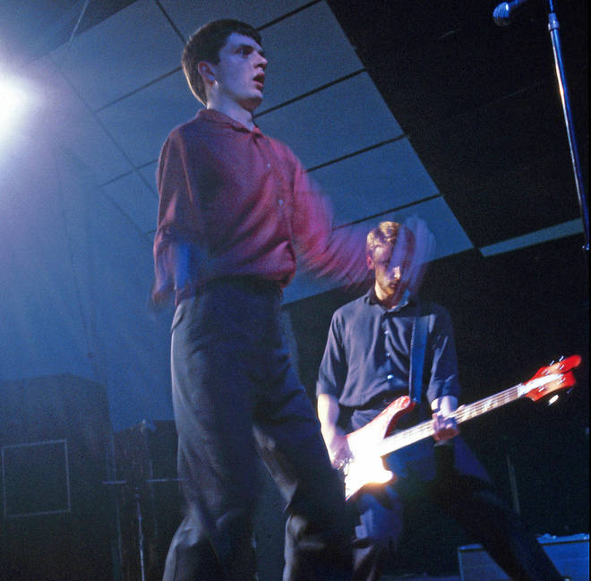 Ian Curtis and Peter Hook onstage as Joy Division at the Electric Ballroom, London on 26 October 1979
