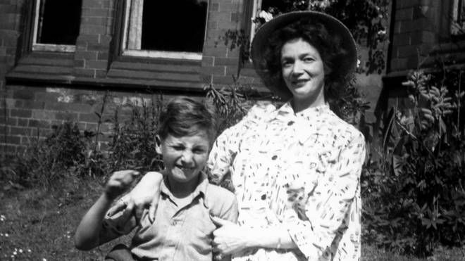 Nine year old John Lennon poses for a portrait with his mother Julia