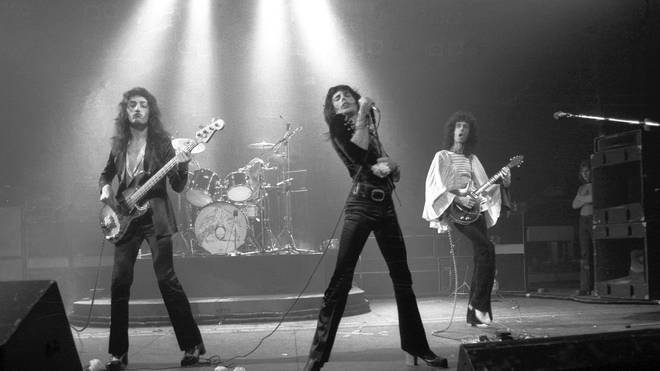 Queen performing live in 1974: John Deacon, Roger Taylor, Freddie Mercury and Brian May