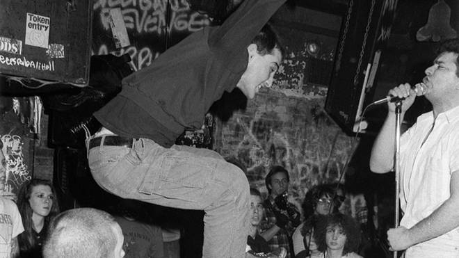 Jimmy Gestapo, lead singer from Murphy's Law jumps as The MOB performs hardcore thrash music at club CBGB's on June 12, 1986