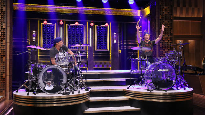 Drummer Chad Smith competes in a drum-off with actor Will Ferrell on May 22, 2014