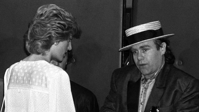 Princess Diana and Elton John meet at Live Aid in Wembley Stadium in 1985