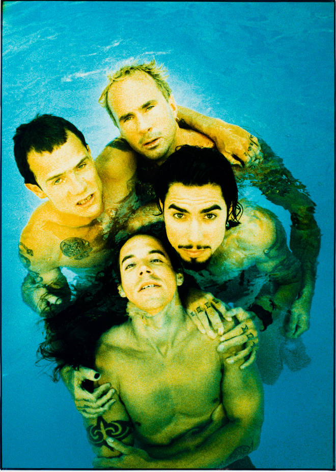 Red Hot Chili Peppers, posed in a swimming pool, Sunset Marquee, Los Angeles, CA, 18th August 1995.