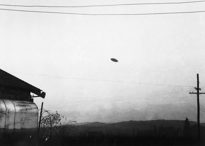 A picture of a flying saucer photographed by farmer Paul Trent shown flying over his farm, November 1950