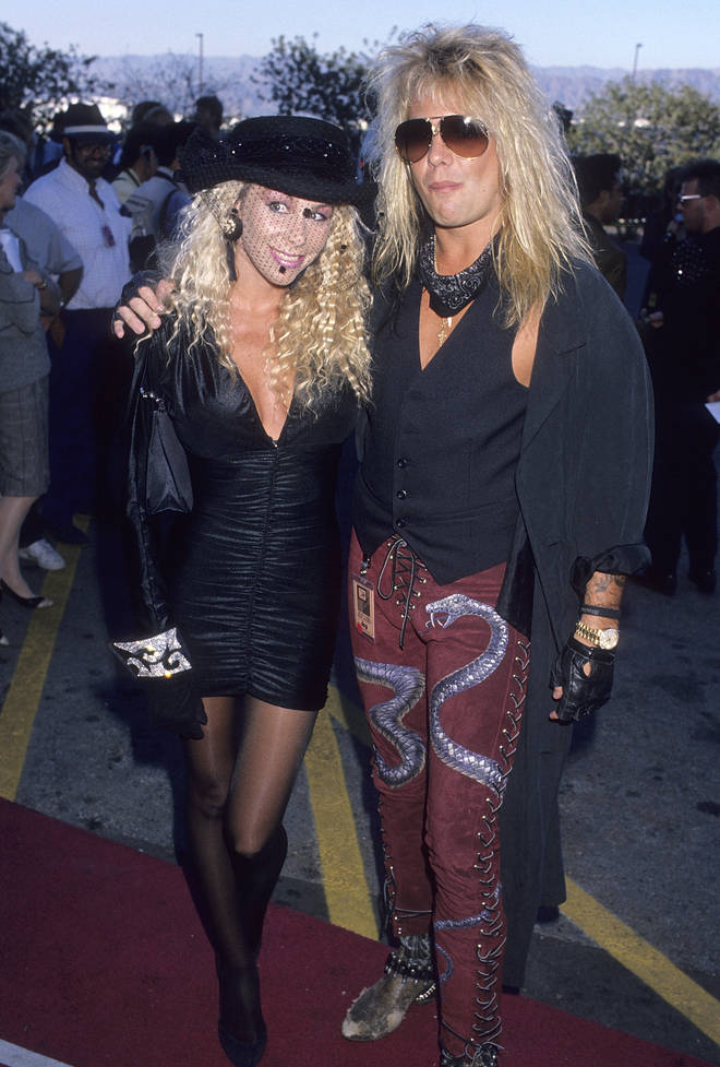 Vince Neil of Motley Crue and wife Sharise Ruddell mere seconds before Izzy Stradlin swung into action (probably): 6 September 1989