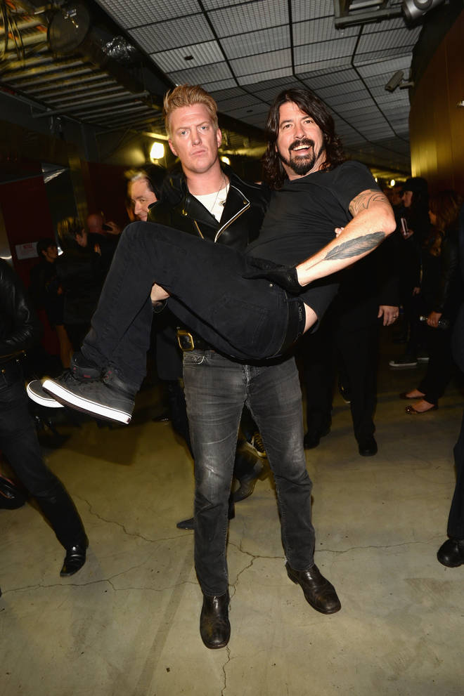 Josh Homme of Queens of the Stone Age and Dave Grohl of Foo Fighters at the Grammys 2014