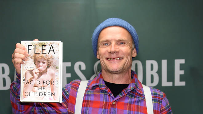Red Hot Chili Peppers' Flea signs copies of his new book Acid For The Children