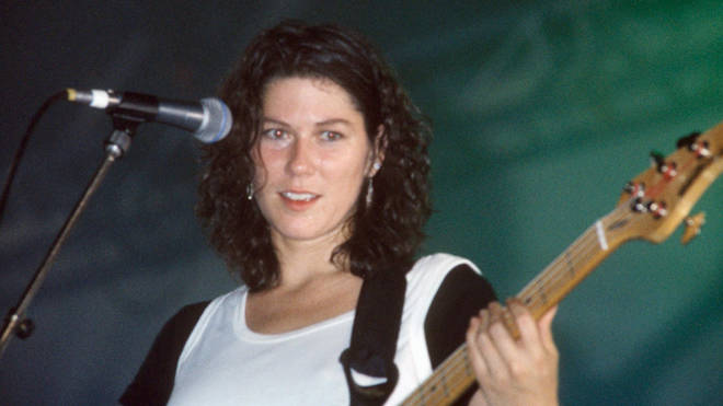 Kim Deal performs with the Pixies at Reading Festival in 1990