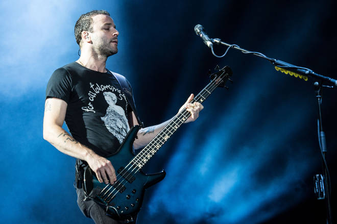 Chris Wolstenholme onstage with Muse at Austin City Limits festival in 2013