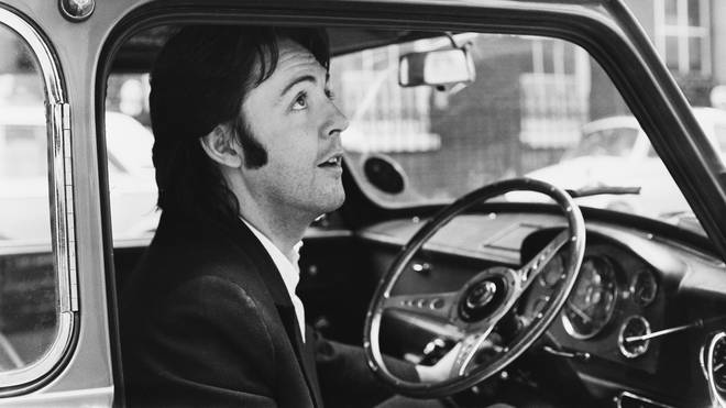 Paul McCartney leaving Apple Headquarters in his Mini, 19 April 1969