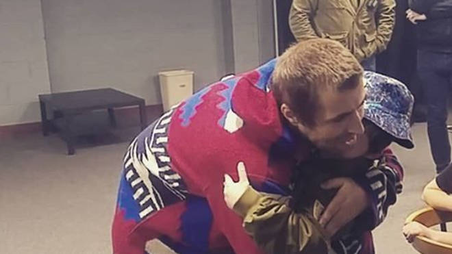 Liam Gallagher hugs super-fan Luca backstage at his Newcastle gig