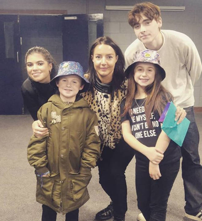 Liam Gallagher's daughter Molly Moorish, son Gene and Debbie Gwyther pose with young Luca and his sister Eva