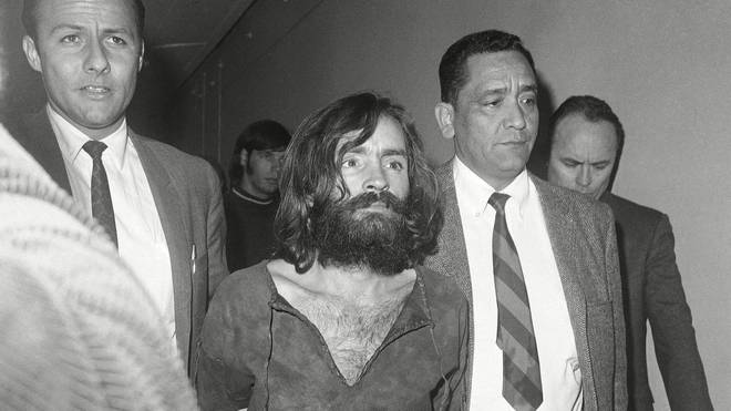 Charles Manson, pictured en route to court in Independence, Calif., for a preliminary hearing on charges of possessing stolen property, December 1969