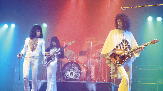 Freddie Mercury, John Deacon and Brian May performing live on stage, 29 November 1975