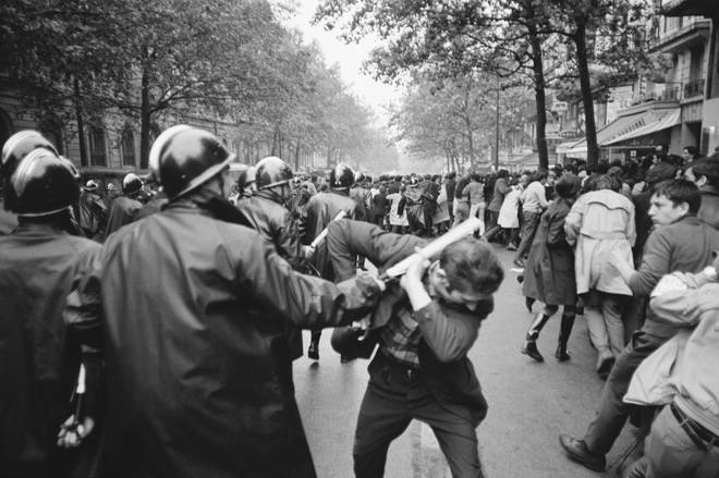 Students injured by policeman on Paris street during violent riots of May 1968.