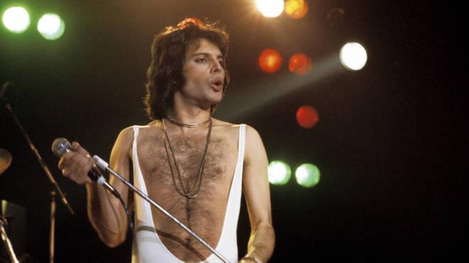 Freddie Mercury performing live on stage at Madison Square Garden, 1977