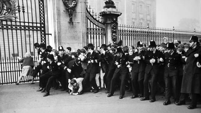 Fans outside Buckinham Palace as The Beatles receive their MBEs, 26 October 1965