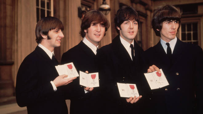 The Beatles outside Buckingham Palace, London, after receiving their MBEs