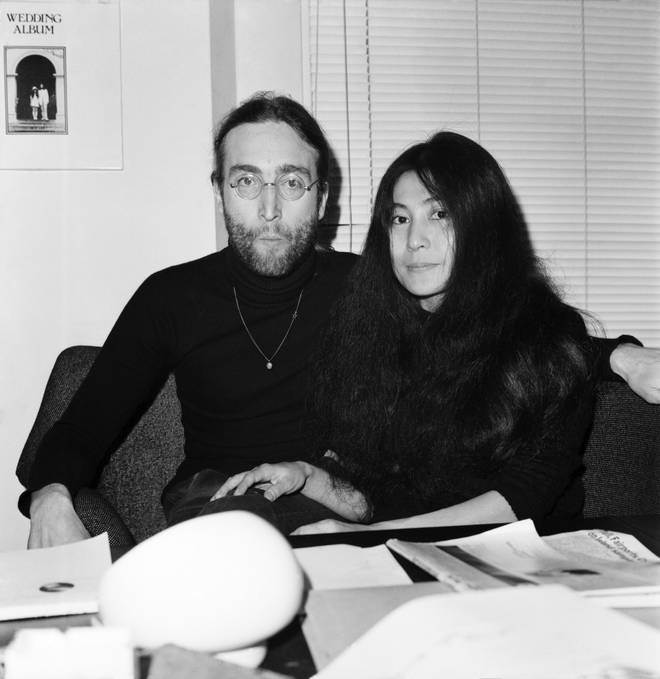 Beatles singer John Lennon with wife Yoko Ono at Apple headquarters as he sends his MBE back to The Queen.