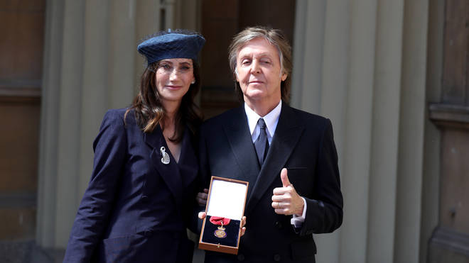 Sir Paul McCartney and his wife Nancy Shevell following an Investiture ceremony, where he was made a Companion of Honour at Buckingham Palace on May 4, 2018